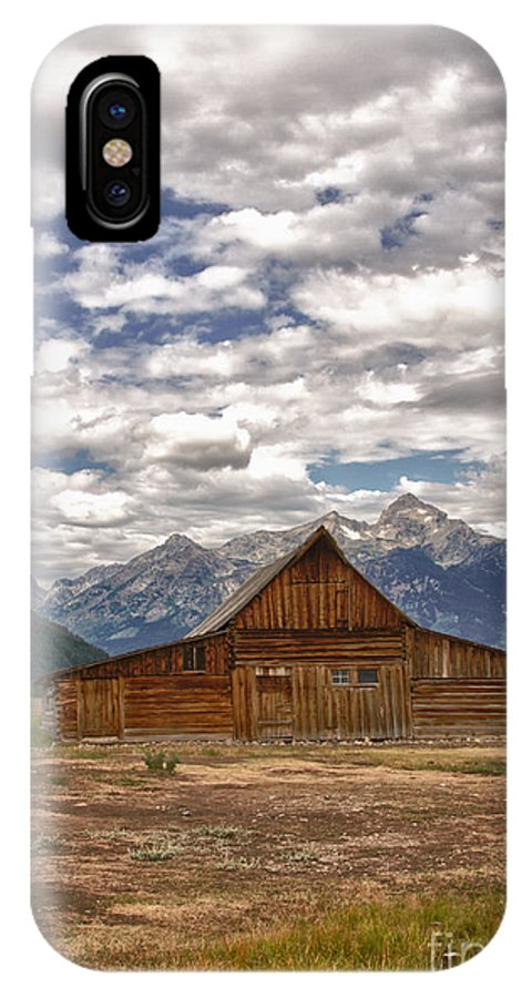 Old Barn IPhone X Case featuring the photograph Clouds Over Mormon Row by Carolyn Fox