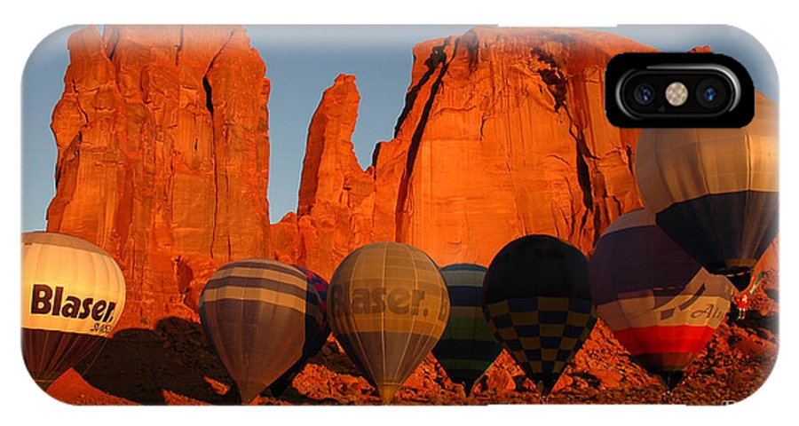Hot Air Balloons IPhone X Case featuring the photograph Dawn Flight In Monument Valley by Vivian Christopher