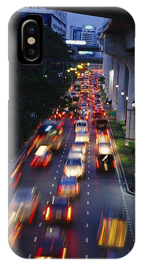 Asia IPhone X / XS Case featuring the photograph Evening Traffic On A Bangkok Street by Richard Nowitz