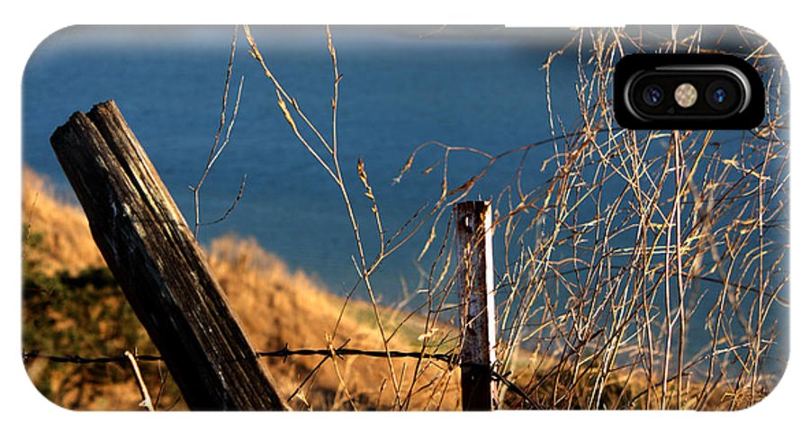 Fence IPhone X Case featuring the photograph Fenceposts by Leonard Sharp