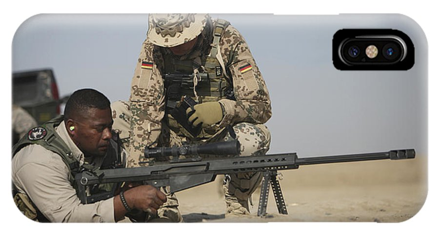 Operation Enduring Freedom IPhone X Case featuring the photograph Fijian Contractor Clearing His Barrett by Terry Moore