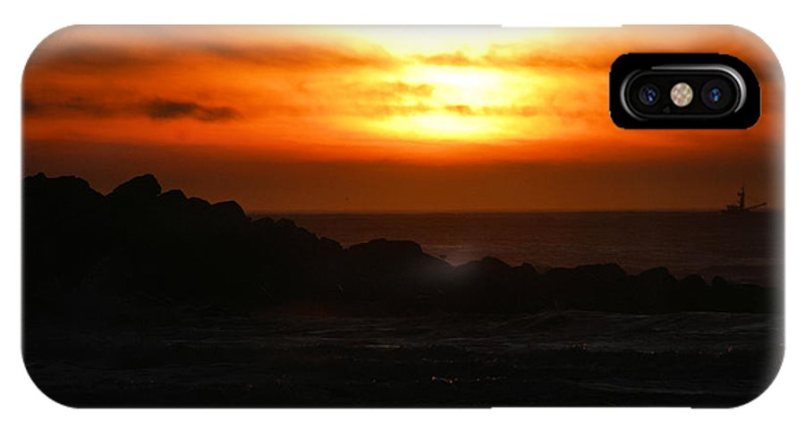 Sunset IPhone X Case featuring the photograph Fishing Vessel At Sunset by Michael Merry