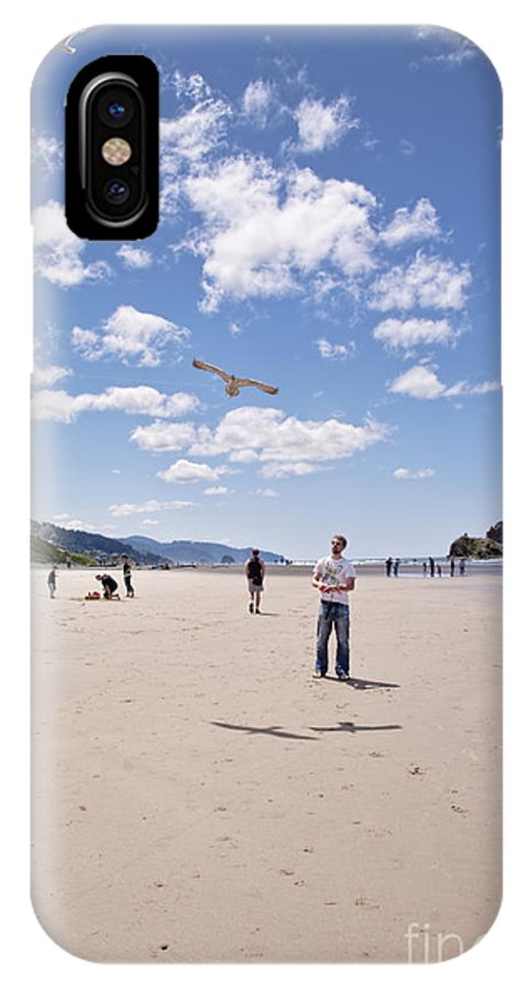 Canon Beach IPhone X Case featuring the photograph Flying A Bird Kite Near Haystack Rock Canon Beach Oregon Usa by Sherry Curry