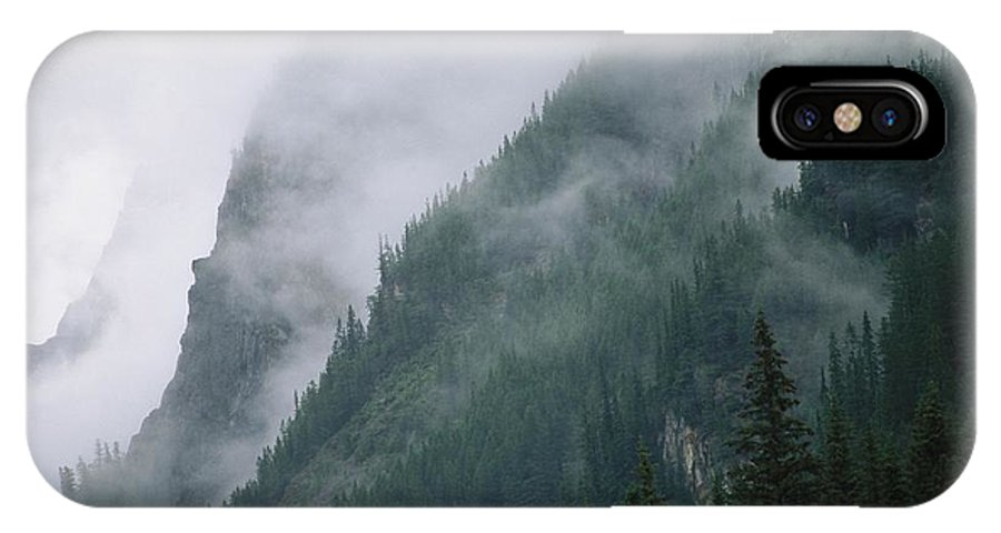 North America IPhone X / XS Case featuring the photograph Fog Blankets Spruce Trees In Yoho by Michael Melford