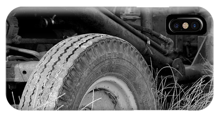 Ford IPhone X Case featuring the photograph Ford Tractor Details In Black And White by Jennifer Ancker