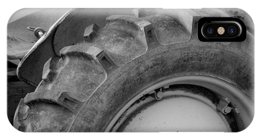 Ford IPhone X Case featuring the photograph Ford Tractor In Black And White by Jennifer Ancker