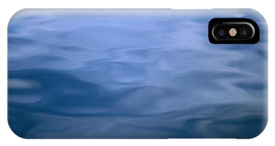 United States Of America IPhone X / XS Case featuring the photograph Gently Rippled Blue Water by Heather Perry