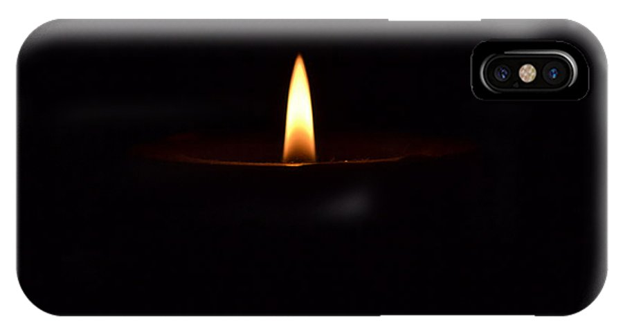 Candle IPhone X Case featuring the photograph Glowing Flame by Dyana Rzentkowski