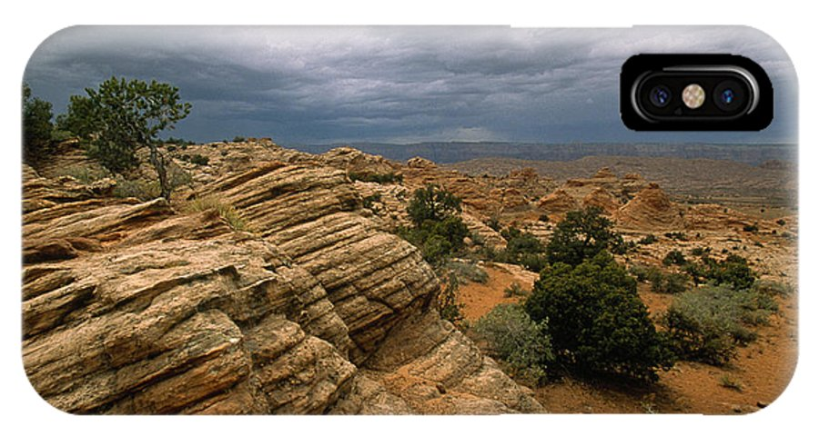 Day IPhone X / XS Case featuring the photograph Heavy Clouds Over A Rocky Desert by Bill Hatcher