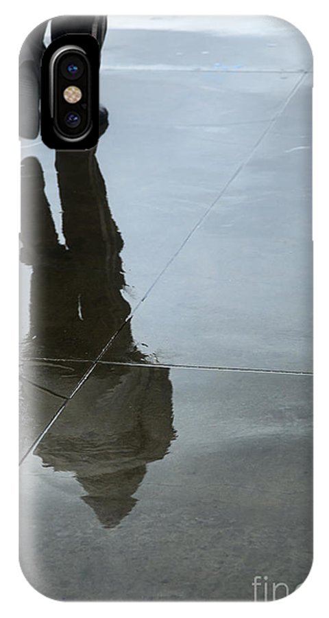 Person IPhone X / XS Case featuring the digital art Inclement Winter Pedestrian by Eldad Carin