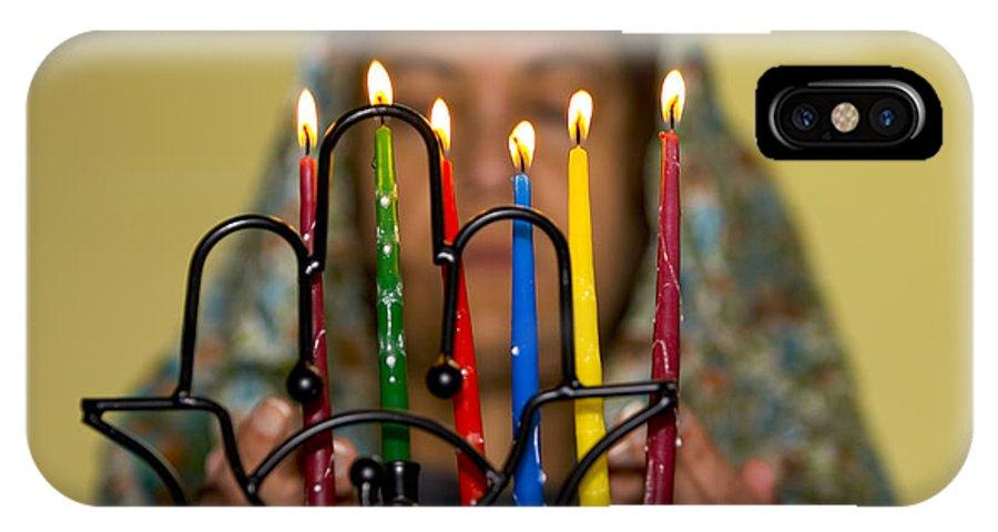 Hanuka IPhone X Case featuring the photograph Lighting The Chanukia by Yossi Aptekar