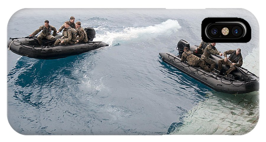 Boat IPhone X Case featuring the photograph Marines Depart The Well Deck by Stocktrek Images