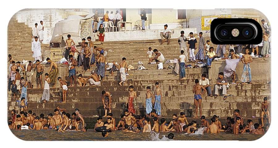 Varanasi IPhone X Case featuring the photograph Men And Boys Bathe At An Ancient Ghat by Jason Edwards
