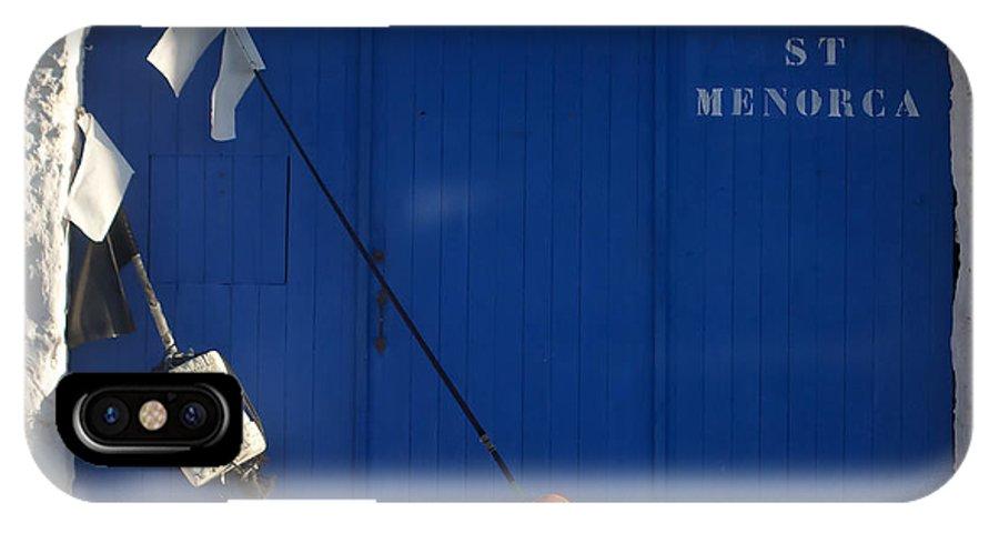 Orange IPhone X Case featuring the photograph menorca st - A warehouse door in Es Castell Menorca ready to keep local tradicional boats llauts by Pedro Cardona Llambias