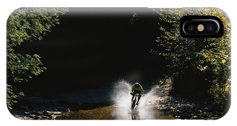 North America IPhone X / XS Case featuring the photograph Mountain Biker Splashing Through Water by Skip Brown