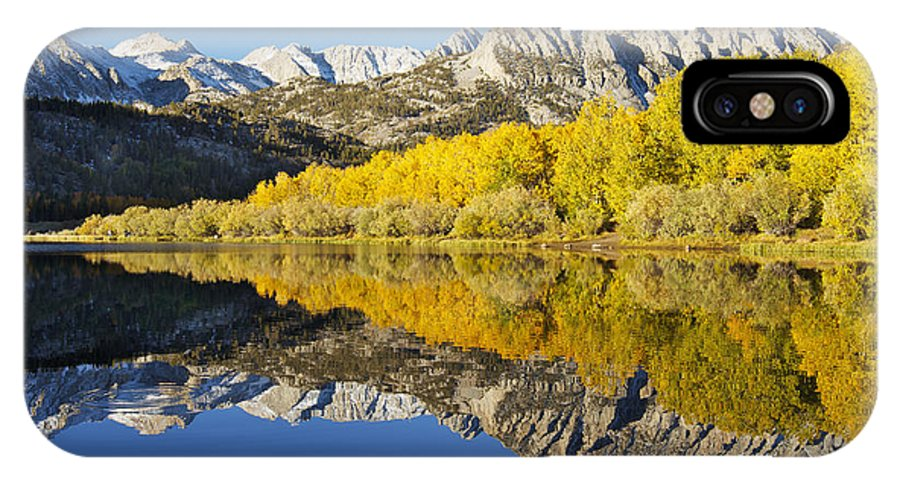 Autumn IPhone X Case featuring the photograph Mountain Mirrored By Lake by MakenaStockMedia