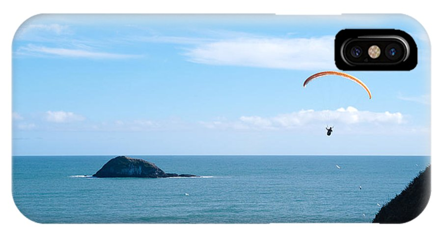 Para-glider IPhone X Case featuring the photograph Paraglider On The Ocean Beach by Yurix Sardinelly
