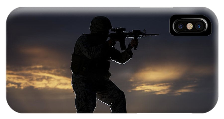 Vigilant IPhone X Case featuring the photograph Partially Silhouetted U.s. Marine by Terry Moore