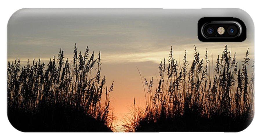 Sunrise IPhone X Case featuring the photograph Peaking Through The Dunes by Kim Galluzzo Wozniak