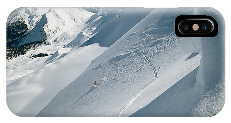 Atkinson IPhone X / XS Case featuring the photograph Phil Atkinson Skiing The Dogtooth Range by Tim Laman