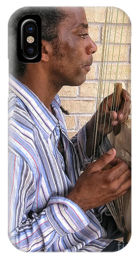Musical Instrument IPhone X Case featuring the photograph Playing The Koro In The Marigny New Orleans by Kathleen K Parker