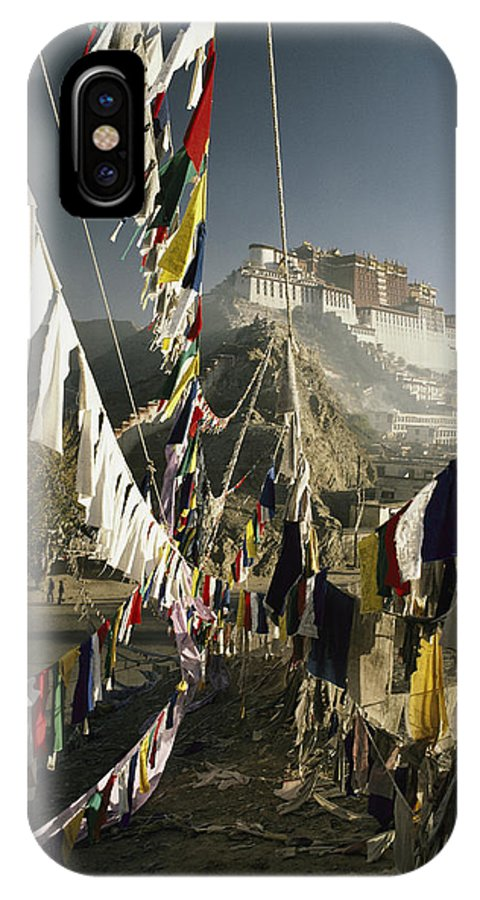 Asia IPhone X / XS Case featuring the photograph Prayer Flags Hang In The Breeze by Gordon Wiltsie
