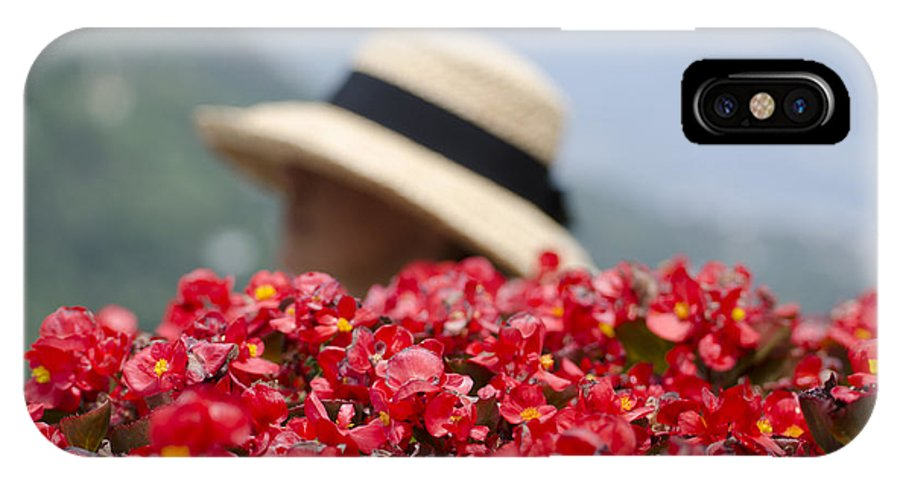 Red IPhone X Case featuring the photograph Red Flowers And Straw Hat by Mats Silvan