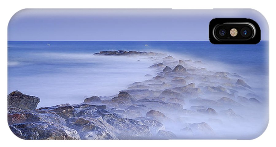 Seascape IPhone X Case featuring the photograph Rocks Fighting Against The Waves by Guido Montanes Castillo
