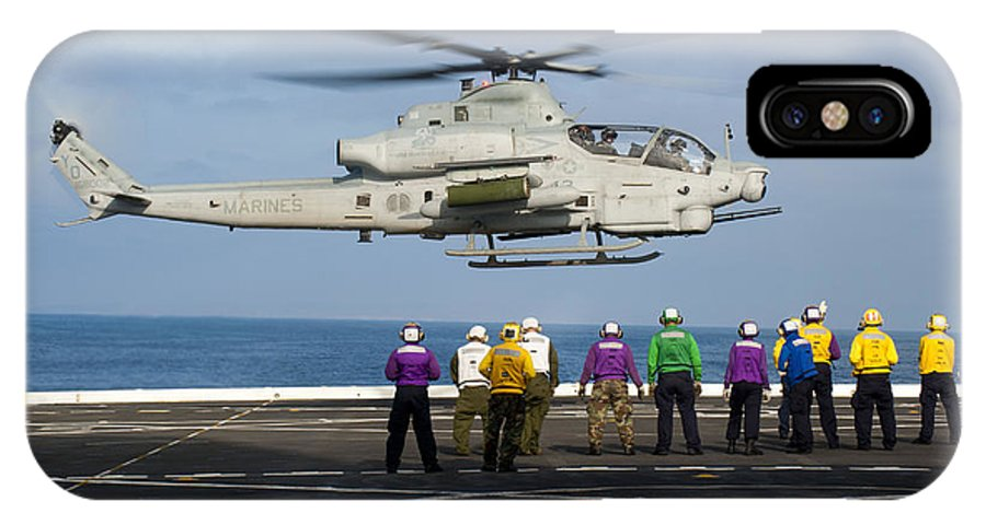 Uss New Orleans IPhone X Case featuring the photograph Sailors And Marines Watch An Ah-1z by Stocktrek Images