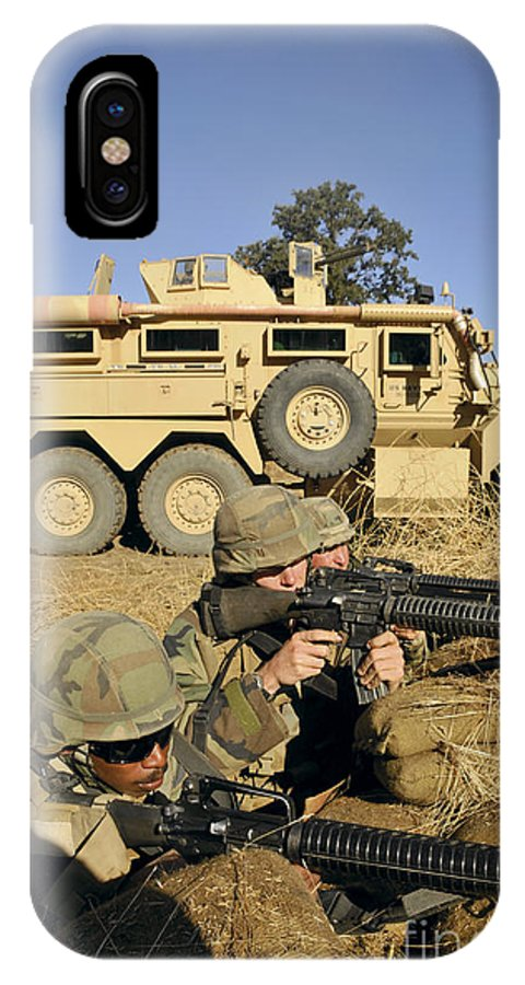 Conflict IPhone X Case featuring the photograph Seabees Defend Their Camp by Stocktrek Images