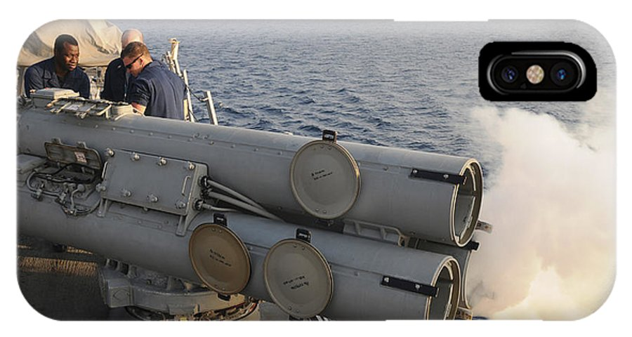 Guided Missile Destroyers IPhone X Case featuring the photograph Seamen Fire An Air Slug From A Mk-32 by Stocktrek Images