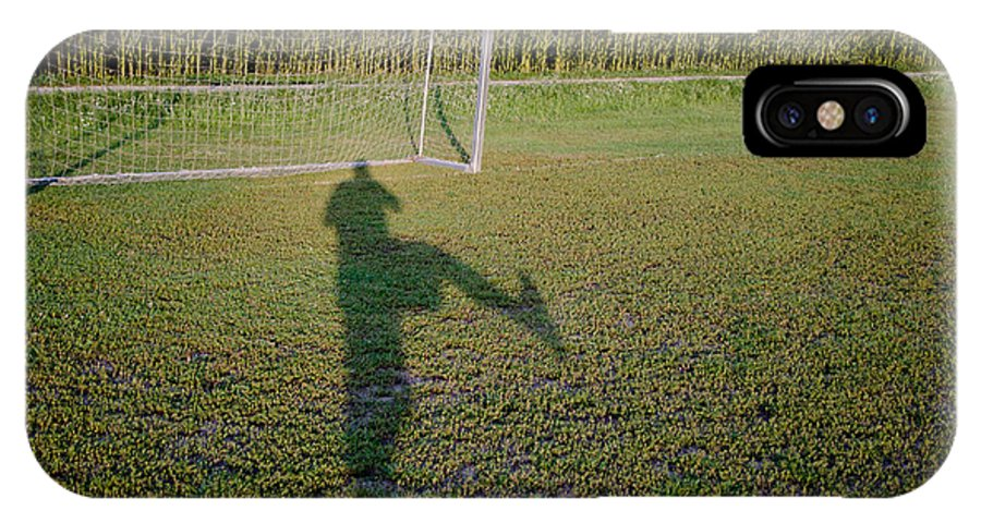 Football IPhone X Case featuring the photograph Shadow From A Football Player by Mats Silvan