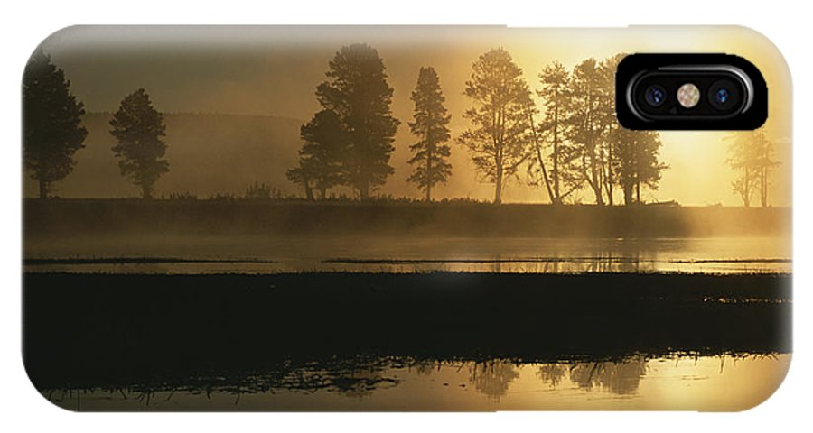 North America IPhone X / XS Case featuring the photograph Silhouetted Trees Along The Yellowstone by Tom Murphy