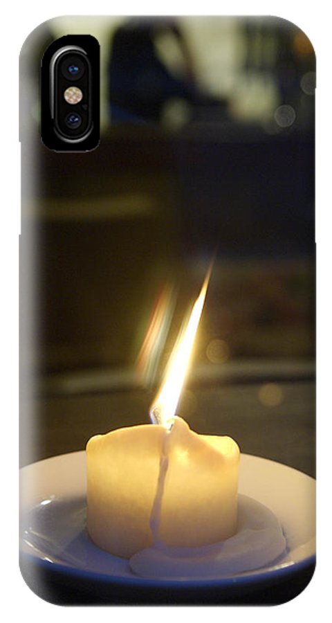 Candle IPhone X Case featuring the photograph Single Candle Flame, Defocussed by Keenpress