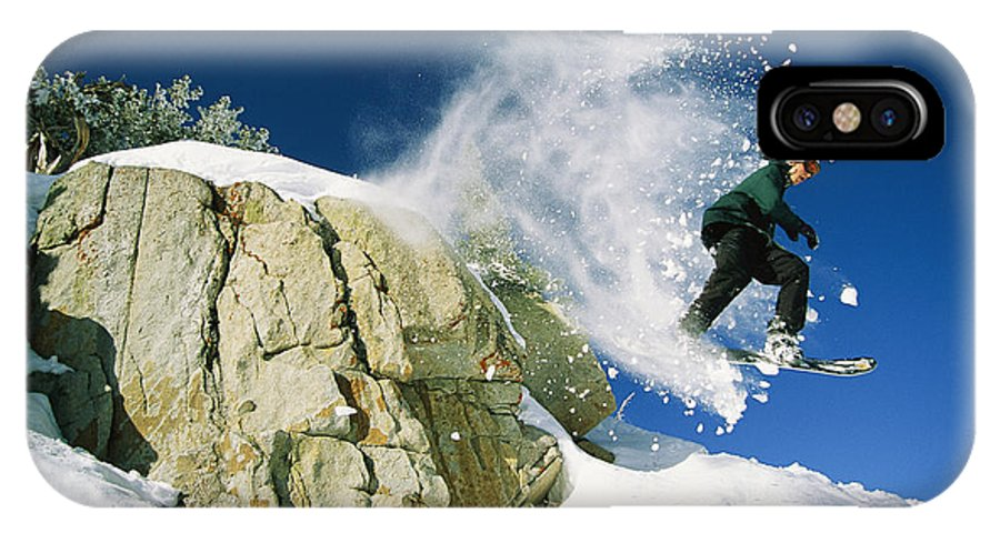 North America IPhone X / XS Case featuring the photograph Snowboarder Jumping Off A Big Rock by Skip Brown