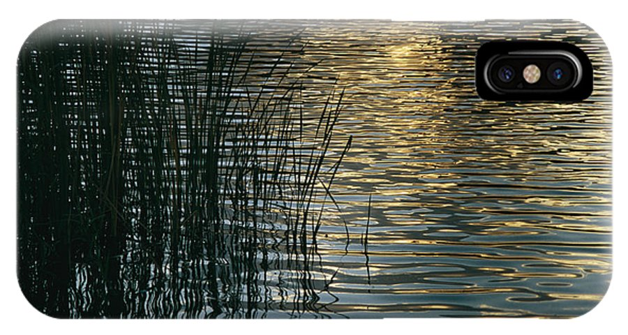 Reflections IPhone X / XS Case featuring the photograph Sunlight Reflects On Rippled Water by Raul Touzon