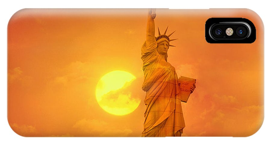 Sun IPhone X / XS Case featuring the photograph Sunset Behind The Statue Of Liberty by Tony Craddock