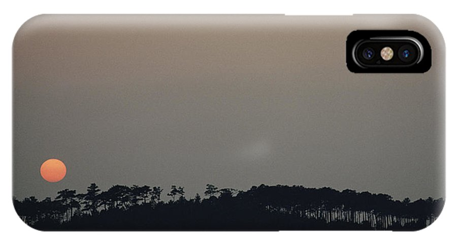 North America IPhone X / XS Case featuring the photograph Sunset Over Pine Trees Near Chesapeake by Skip Brown