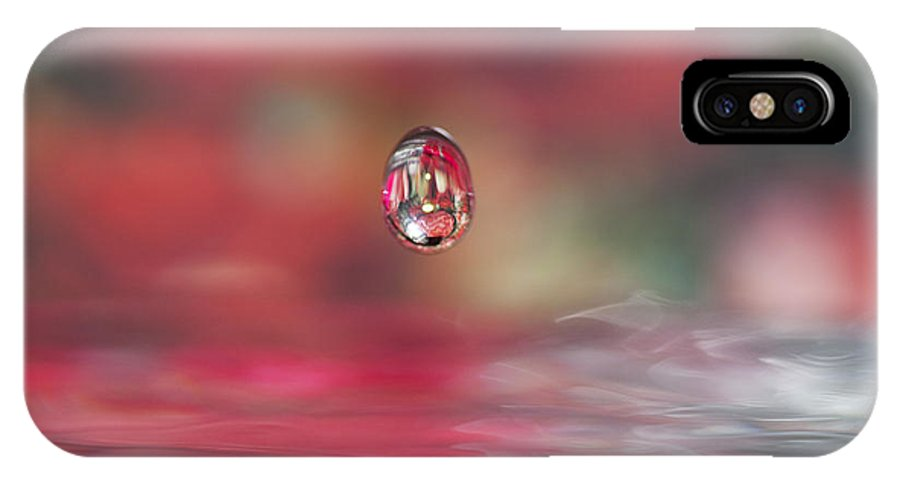 Waterdrop IPhone X / XS Case featuring the photograph Suspended Animation by Kathy Clark
