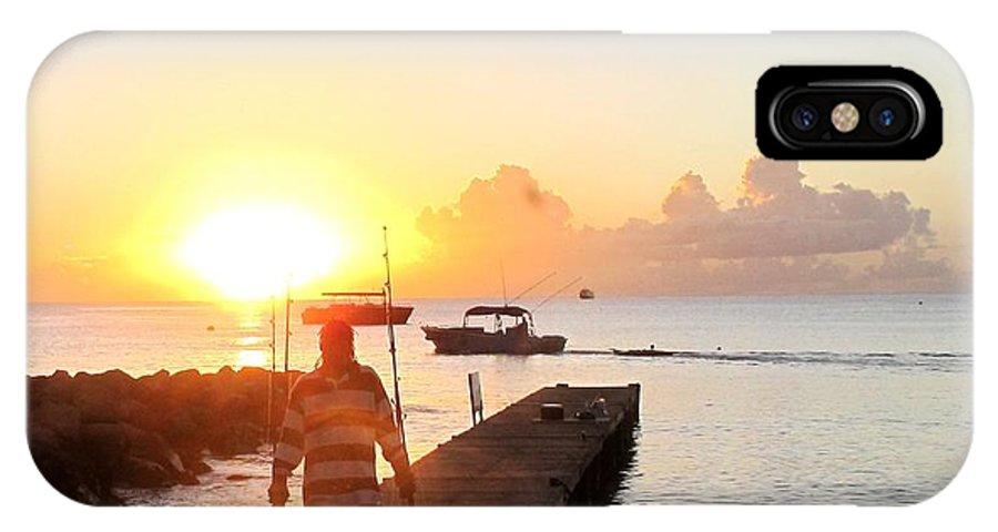 Fisherman IPhone X Case featuring the photograph The Fisherman Returns by Ian MacDonald