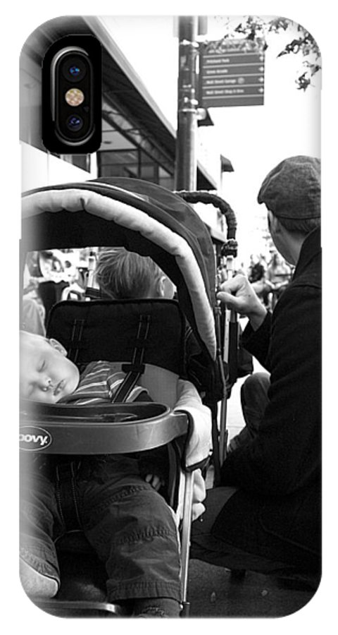 Baby IPhone X Case featuring the photograph Tired Child Sleeping In Baby Stroller With Dad by Gray Artus
