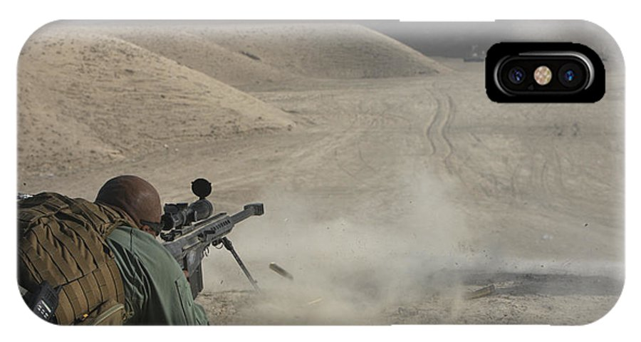 Isaf IPhone X Case featuring the photograph U.s. Army Soldier Fires A Barrett M82a1 by Terry Moore