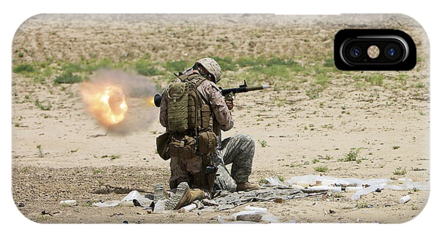 Afghanistan IPhone X Case featuring the photograph U.s. Army Soldier Fires by Terry Moore