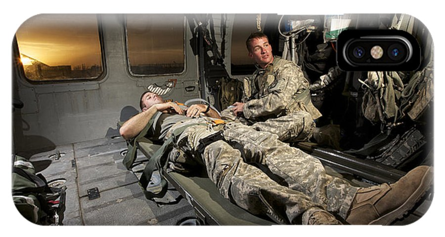 Us Army IPhone X Case featuring the photograph U.s. Army Specialist Practices Giving by Terry Moore