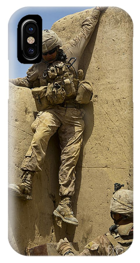 Afghanistan IPhone X Case featuring the photograph U.s. Marine Climbs Down From An by Stocktrek Images