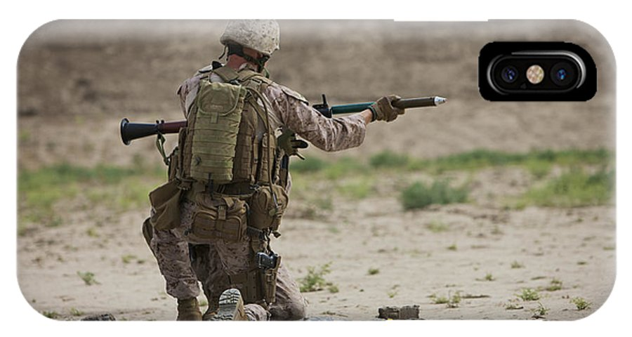 Soldier IPhone X Case featuring the photograph U.s. Marine Prepares A Fragmentation by Terry Moore
