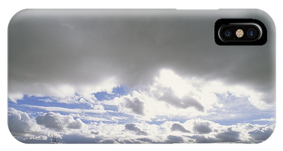 North America IPhone X / XS Case featuring the photograph View Of A Train Carrying Coal by James P. Blair