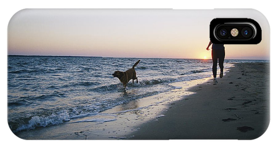 North America IPhone X / XS Case featuring the photograph Woman And Dog Running On Beach, Nags by Skip Brown