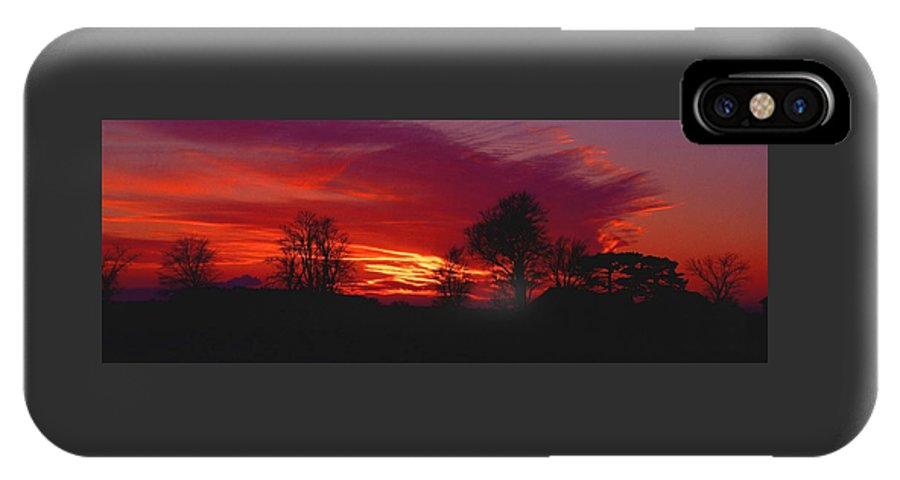 Sunset IPhone Case featuring the photograph 022107-37 by Mike Davis