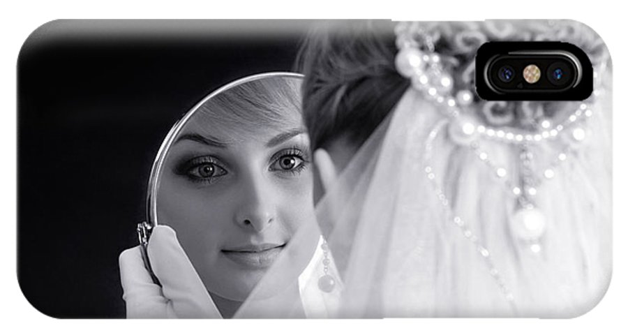 Bride IPhone X Case featuring the photograph Beautiful Woman In Bridal Veil Looking At A Mirror by Oleksiy Maksymenko